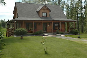 Six year old True North Log Home situated on 11 treed acres