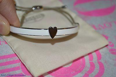 - Fossil Brand Silvertone Stainless Heart White Enamel Leather Pulley Bracelet $38