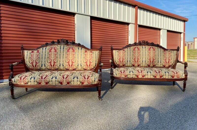 Pair of American Renaissance Carved Rosewood and Grained Settees , c. 1860