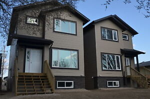 Newer Beautiful and Spacious 5 Bedroom Home with Garage