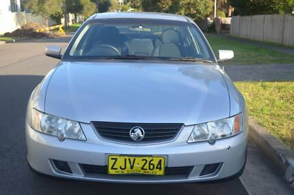 2004 Holden Commodore LOW KM, LOG BOOKS, REGO,AUTO,AIR,STEER