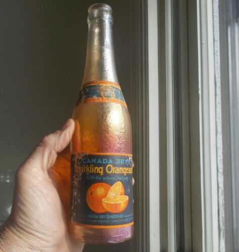BEAUTIFUL ORANGE & GOLD CARNIVAL GLASS CANADA DRY GINGER ALE BOTTLE WITH LABELS