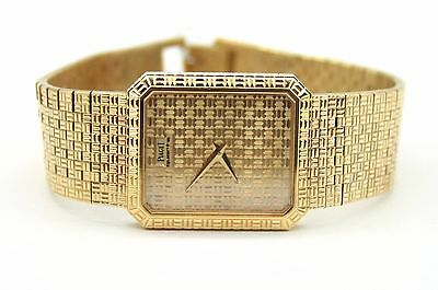 VINTAGE MEN`S PIAGET 18K YELLOW GOLD QUARTZ WATCH.24mmX28mm.crown on the back