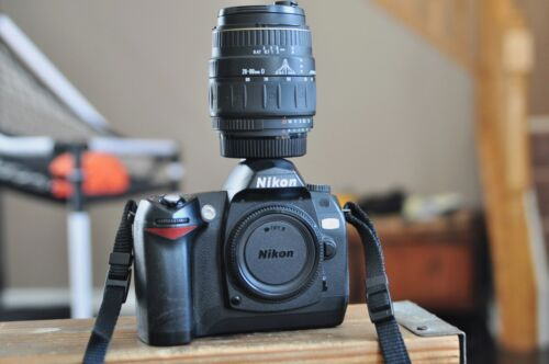 Nikon d70 camera body with a lens and more