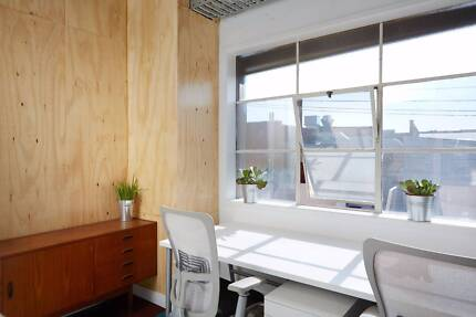 Desks and offices in creative co-working wharehouse