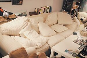 Three seater cream sofa couch