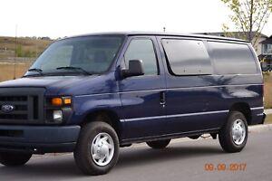 Ford. 8 passenger Window van