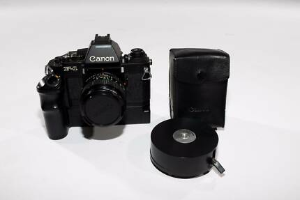 MINT RARE Canon F1-N (New w/ AE Prism) W/ 2 LENSES, FLASH + MORE!