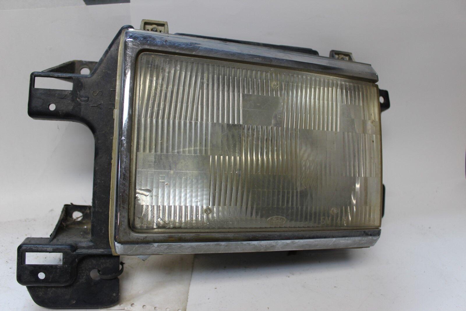 Original OEM Ford Headlight with Bracket E7TB-13006-AB 1987-91 F150 F250  (SVM6