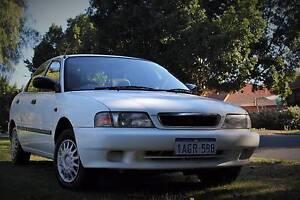 1998 Suzuki Baleno sedan. Manual 3 month Rego Carlisle Victoria Park Area Preview