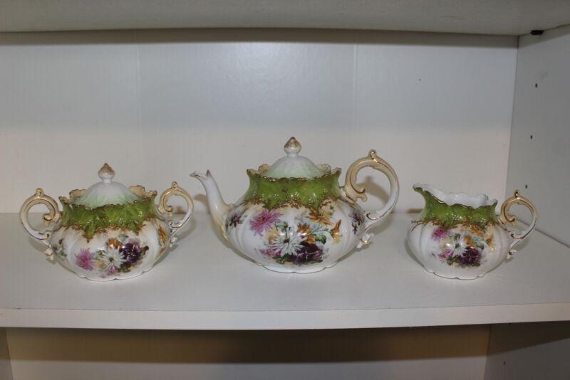 ANTIQUE HAND PAINTED PORCELAIN TEA SET-TEAPOT, CREAMER, & SUGAR BOWL W/LID