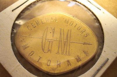 GENERAL MTRS  1955 MOTORAMA, ORIGINAL METAL TOKEN PREOWNED