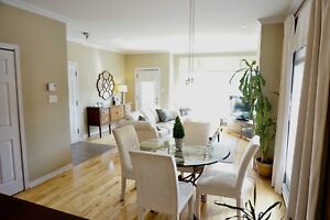 Dining room table & four off-white parsons chairs.