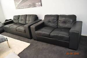 2 black leather lounges 3 seater and 2 seater Carrara Gold Coast City Preview
