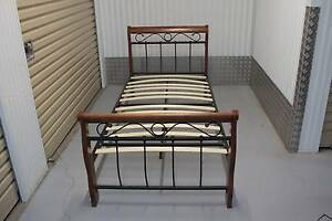 Single wood and wrought iron Bed very good condition Kelvin Grove Brisbane North West Preview