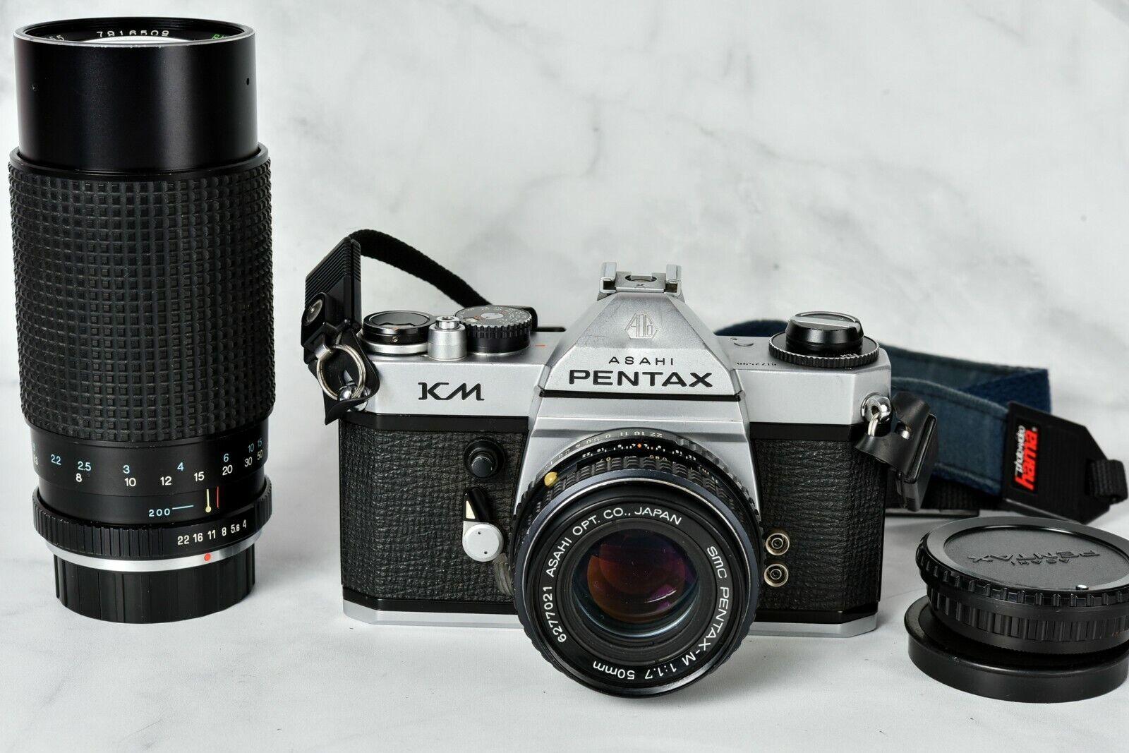 Pentax KM SLR camera + Pentax-M 50mm 1.7 and RMC Tokina 80-200mm lenses