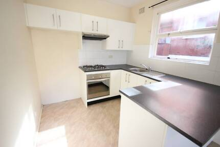 SPACIOUS RENOVATED ONE BEDROOM UNIT WITH CAR SPACE