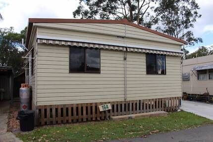Riverfront movable dwelling for sale