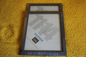 Two 11 x 14 picture frames. Studio Decor $25 for both