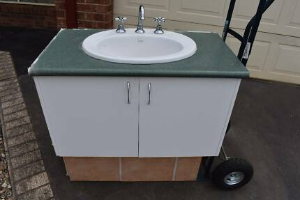 free bathroom vanity out the fornt of 3 davies ave melton
