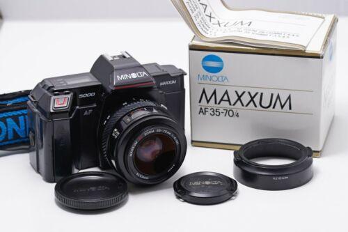 Minolta Maxxum 5000 with 35-70mm/4.0 lens. Everything works.