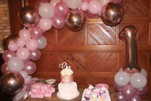 Pink garland and 1 stand used decorations for party/cake smash