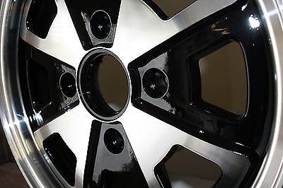 914 Fuch Wheel, Black and Silver, 8 Spoke O.E, With Center Cap & Valve Stem, New