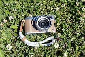 Fuji X00S Silver with wood covering