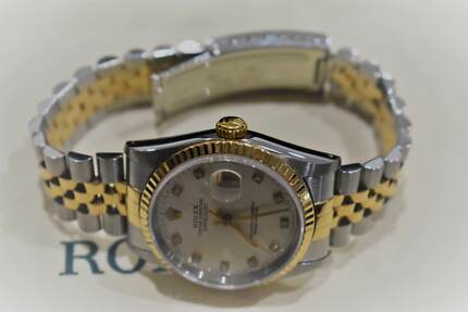Rolex Oyster Perpetual Datejust Champagne Diamond Dial