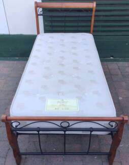 Excellent metal frame single bed with mattress for sale. Delivery