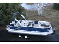 Two tube-New 24 ft rear fish pontoon boat with 115 hp and trailer