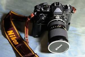 Nikon FE camera, MD-12 drive, 25-50mm lens, bag