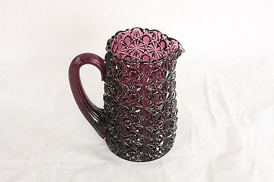 AMETHYST GLASS DAISY & BUTTON PATTERN PITCHER WITH REEDED HANDLE L G WRIGHT