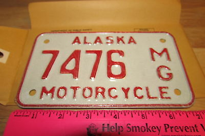 Alaska Motorcycle License Plate numbered 7476, NEW and Unused, expired in 1976