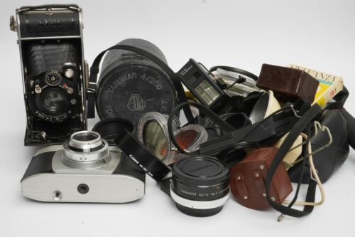 a bag with old cameras and accessoires, as found