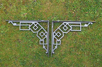 A pair of large cast iron Art Deco shelf brackets geometric design bracket