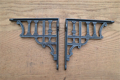 A pair of antique classical column cast iron shelf brackets cistern bracket AL75
