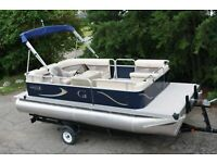 New 18 ft  pontoon boat with 25  hp and trailer