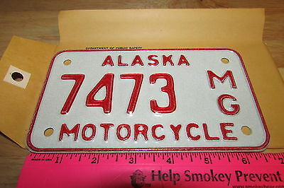 Alaska Motorcycle License Plate numbered 7473, NEW and Unused, expired in 1976