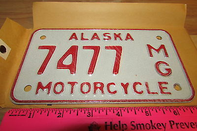 Alaska Motorcycle License Plate numbered 7477, NEW and Unused, expired in 1976