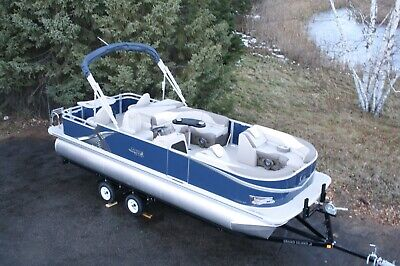 New 24 ft  two tube pontoon boat with 115 hp and trailer