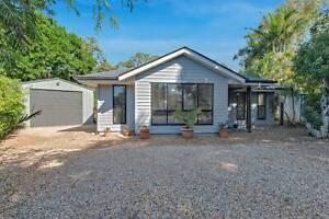 Stunning private block by beach with low set 5 yr new modern home