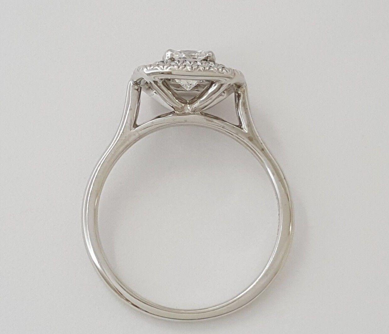 0.97 ct 18K White Gold Cushion Cut Diamond Double Halo Engagement Ring GIA E/VS1 7