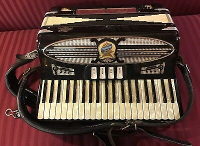 RARE Antique General Accordion (plays Perfectly). Mother of Pearl keys w/case