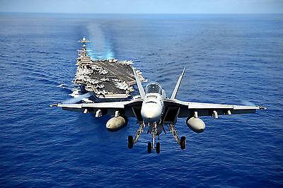 An F/A-18E Super Hornet from Tophatters Flies over Carrier USS John C. Stennis