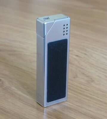 Vintage Braun lighter silver/black piezo - working