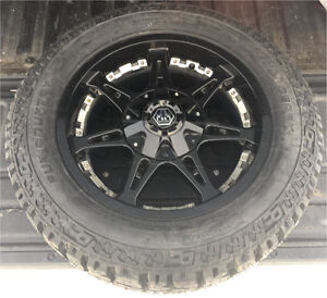 "Toyota Tundra 4 x 20"" x 12"" x 33"" tires and rims"