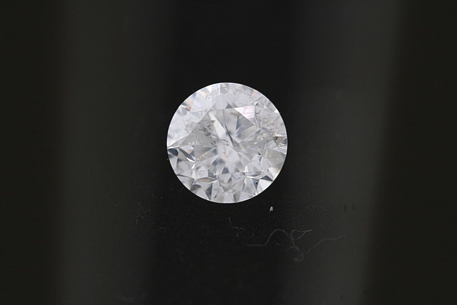 GIA .77ct Round Loose Diamond H color, I2 clarity 5.56-5.59 x 3.79mm