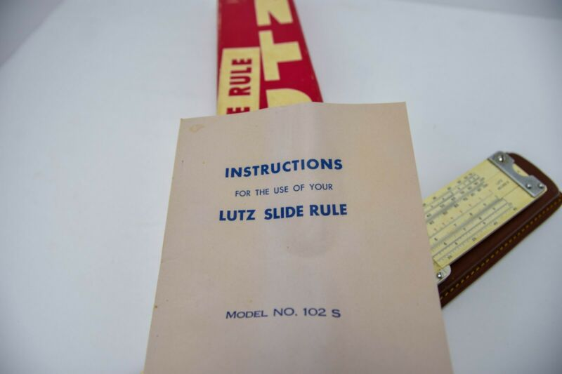 VINTAGE LUTZ SLIDE RULE 102s WITH LEATHER SHEATH CASE AND INSTRUCTIONAL HOW TO B