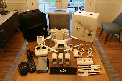DJI Phantom 4 Drone with Extra Batteries, Carry Bag, and Much More!
